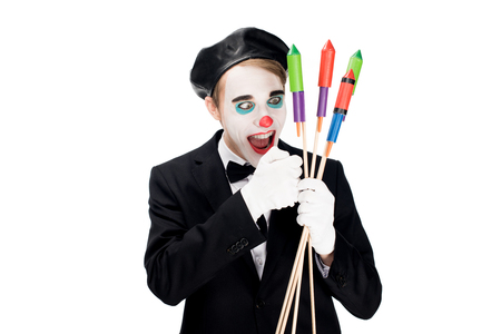 crazy clown looking at firecrackers isolated on white
