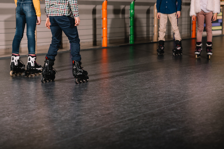 Partial view of preteen roller skaters practicing together