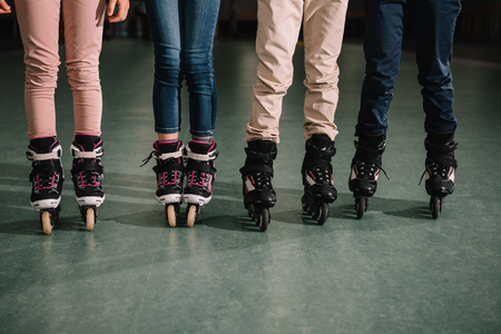 Cropped view of childrens team in roller skates