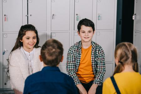 Group of children talking in changing room 版權商用圖片