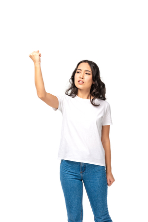 Angry young asian woman quarreling and showing raised fist isolated on white