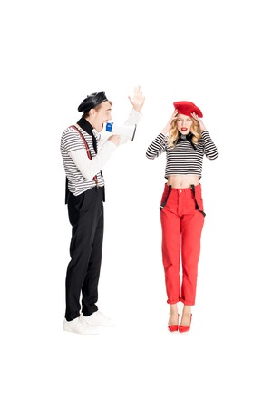 angry man yelling in megaphone on attractive woman isolated on white