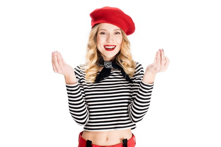 attractive woman in red beret smiling while gesturing isolated on white