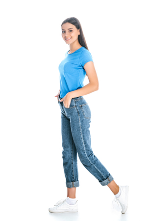 side view of stylish woman in jeans isolated on white Banque d'images - 117852944