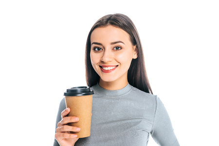 portrait of smiling attractive woman with coffee to go isolated on white
