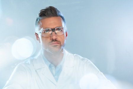portrait of handsome scientist in protective glasses looking up isolated on white, artificial intelligence concept