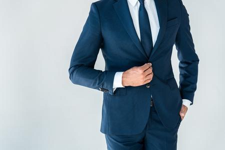 cropped image of businessman buttoning jacket isolated on white Stock Photo