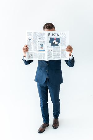 businessman covering face with newspaper isolated on white