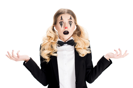 blonde female clown showing shrug gesture isolated on white