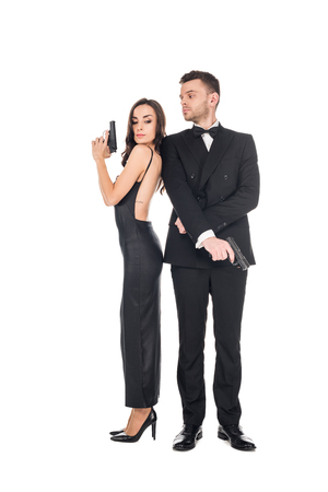 couple of killers in black clothes posing with guns, isolated on white