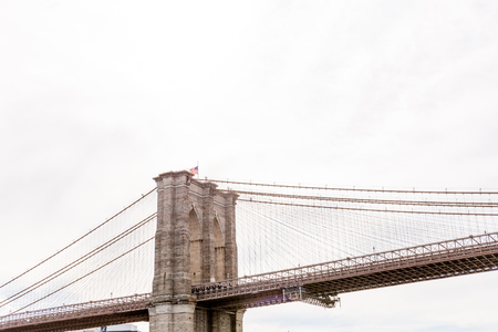low angle view of brooklyn bridge and cloudy sky on background, new york, usa 写真素材