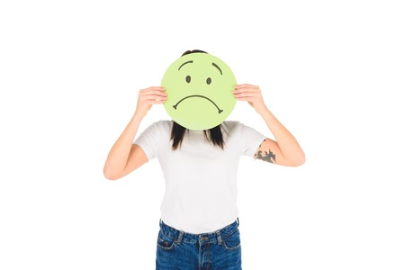 woman holding green sign with sad face expression isolated on white Stock fotó