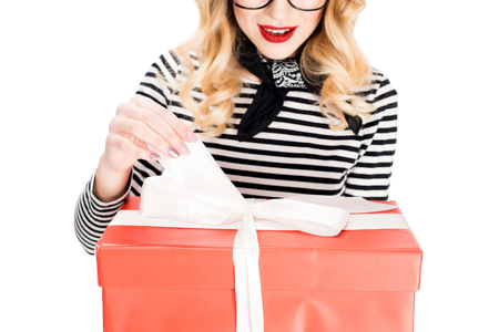cropped view of woman looking at gift box with ribbon isolated on white