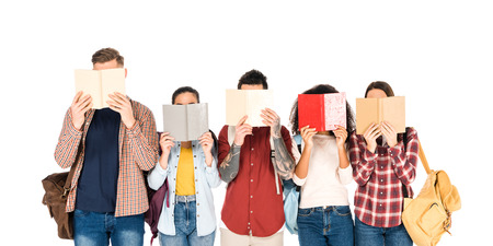 group of students reading books and holding backpacks isolated on white Stock fotó