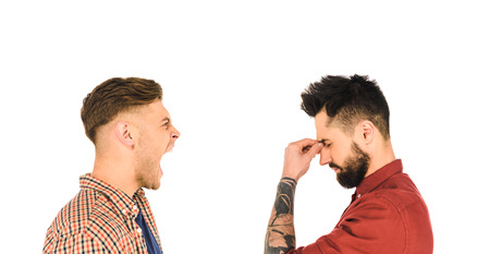 side view of handsome man with headache and screaming man isolated on white Stock Photo