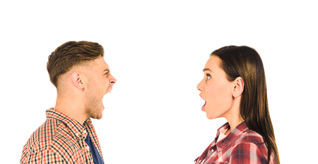 profile of surprised girl and screaming man  isolated on white Stock Photo
