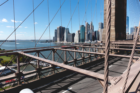 urban scene of manhattan from brooklyn bridge in new york, usa