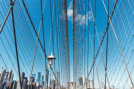 brooklyn bridge on blue sky and manhattan on background, new york, usa 写真素材