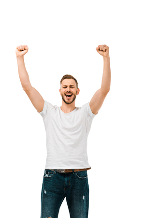 handsome happy man raising hands and shaking fists isolated on white Stock Photo