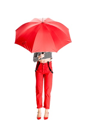 woman holding red umbrella while standing isolated on white