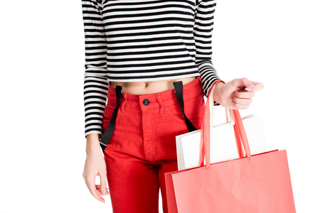 cropped view of woman standing with shopping bags isolated on white Stock fotó