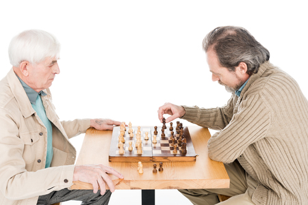retired friends playing chess isolated on white Banco de Imagens - 118053285