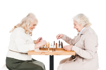 retired women playing chess isolated on white