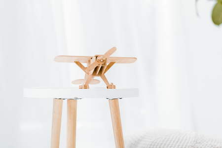 close up of wooden toy plane on table