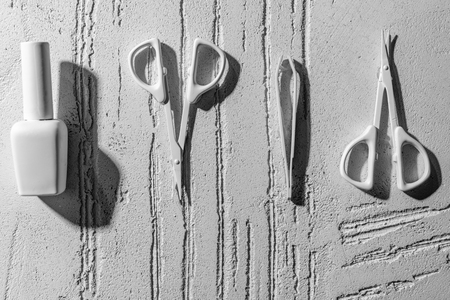close-up view of decorative manicure tools on wall in beauty salon