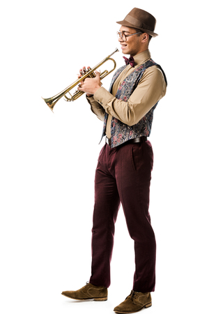 handsome young mixed race male jazzman posing with trumpet isolated on white Stok Fotoğraf