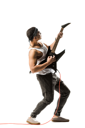 handsome young male rock musician playing on electric guitar isolated on white