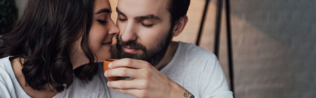 beautiful young couple drinking coffee in morning with copy space Stock Photo