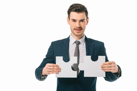 handsome businessman holding puzzle pieces isolated on white, business idea concept Banque d'images - 117438492