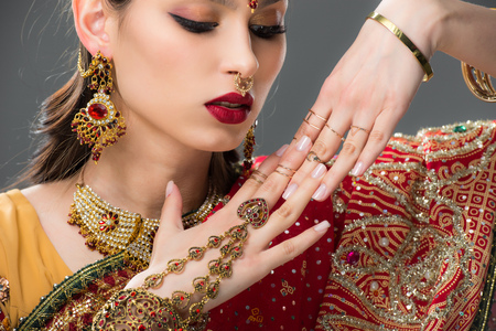beautiful indian woman in sari and accessories on hands, isolated on grey Stock fotó