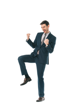 successful businessman in suit celebrating triumph isolated on white