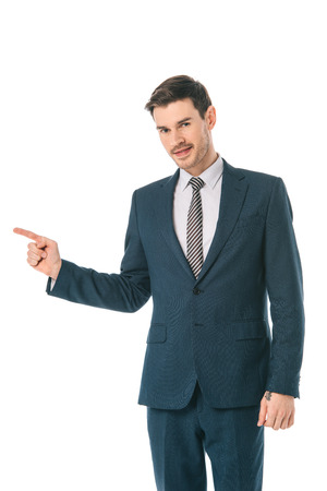 successful businessman pointing at something isolated on white Stock fotó