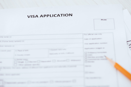 selective focus of visa application lettering on document near wooden pencil Stock fotó