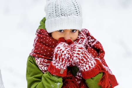 cute african american child in warm clothing at white background 写真素材