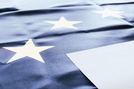 white empty blank with european flag on background