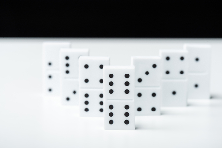 selective focus of domino row isolated on black Stock Photo