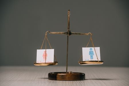 male and female symbols on scales on wooden table on grey, gender equality concept Foto de archivo - 117395953