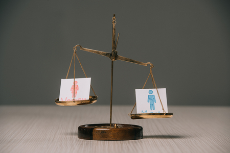 male and female signs on scales on grey, gender equality concept Foto de archivo - 117395955