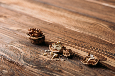 cracked walnuts as alzheimer symbol on wooden table