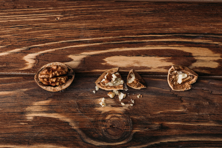 top view of walnuts in nut shells as dementia symbol on wooden table