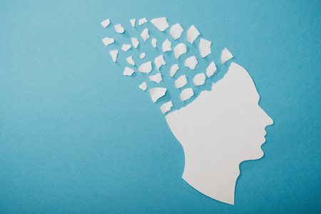 dementia symbol presented as face isolated on blue Banque d'images