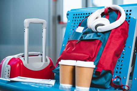 headphones on backpack near paper cups and baggage in airport 版權商用圖片 - 117438754