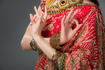 cropped view of indian woman in traditional clothing showing gyan mudra, isolated on grey Stock Photo - 117398399