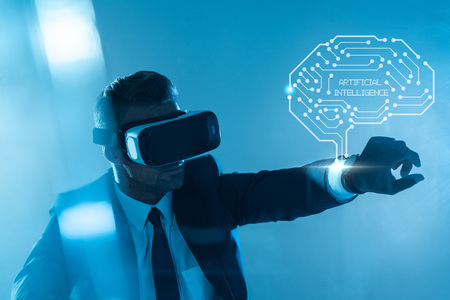 businessman in virtual reality headset with brain isolated on blue, artificial intelligence concept Standard-Bild