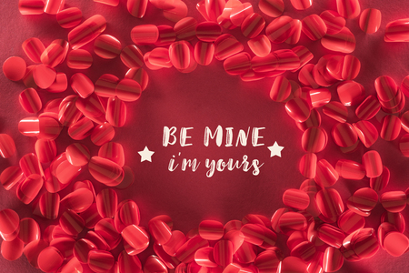 round frame and beautiful decorative red petals with be mine i am yours lettering, valentines day background