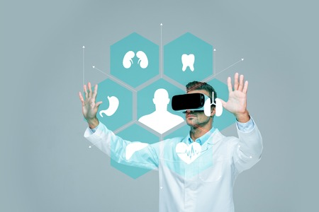 scientist in virtual reality headset touching medical interface in air isolated on grey, artificial intelligence concept
